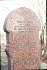 Art Nouveau headstone in polished granite: M W Cunningham 1907. 23/3/88