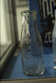 Exhibition: old milk bottle (Tel-el-Kebir Dairy, Monkstown).  5/5/88