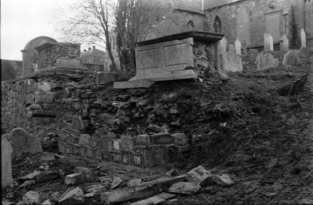chest tomb being repaired.