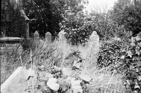 Headstones at the back of the church before clearing.
