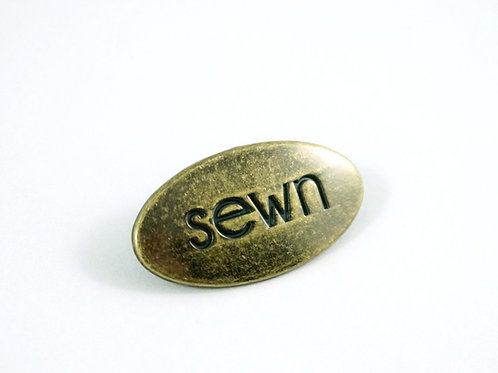 "Metal Bag Label: ""Sewn"""