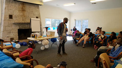 Musician and artist Tee DeWitt speaking to the kids about how writing is reflected in music