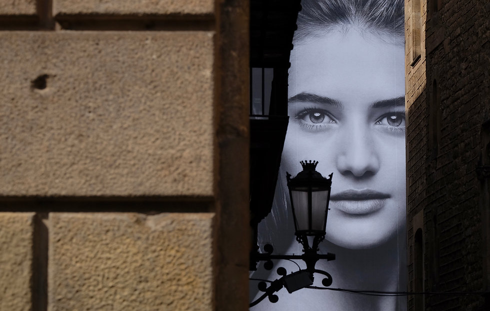 Old town and large female face on poster