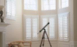 white plantation wooden shutters in a bay window