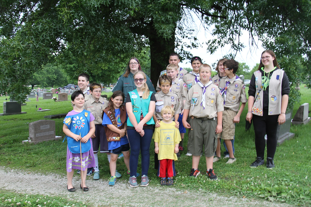Scouts from Pack, Troop and Crew 124 gathered with the American Legion and local residents to present each grave with an American flag as part of the Memorial Day celebration.