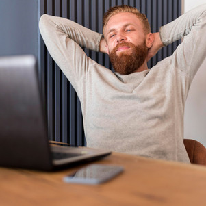 bearded-man-relaxing-office.jpg
