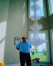 Sibilano Chandeliers designed Angelo Sibilano with one of his crystal chandeliers.