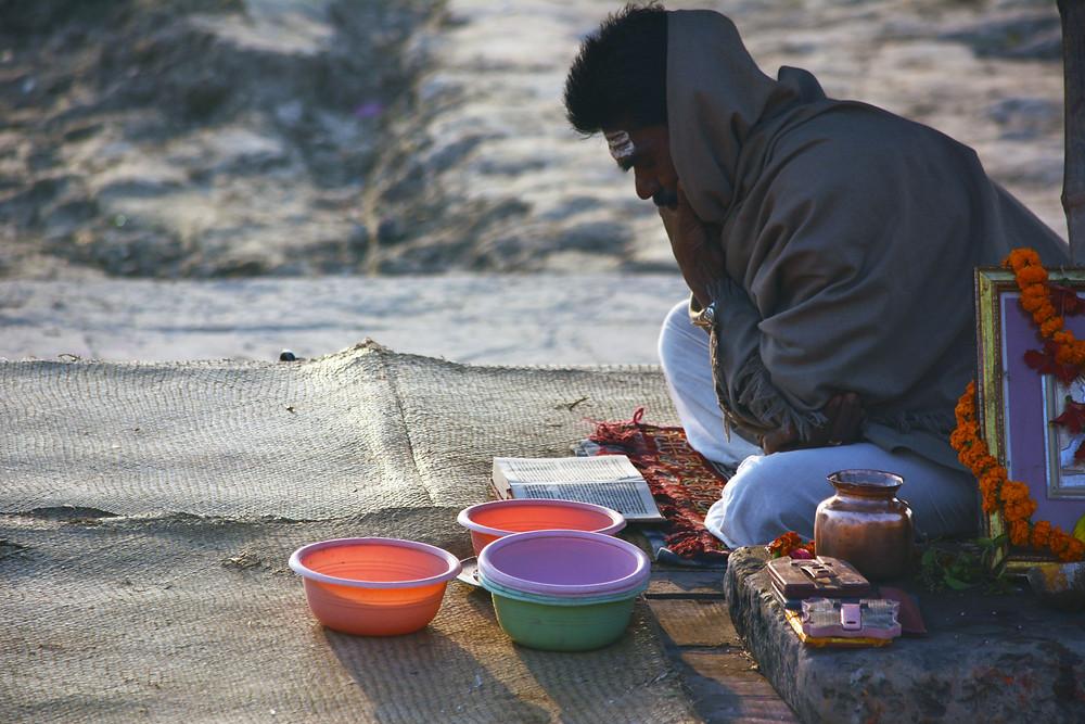 Man praying- social determinants