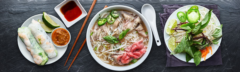 vietnamese beef pho with spring rolls in
