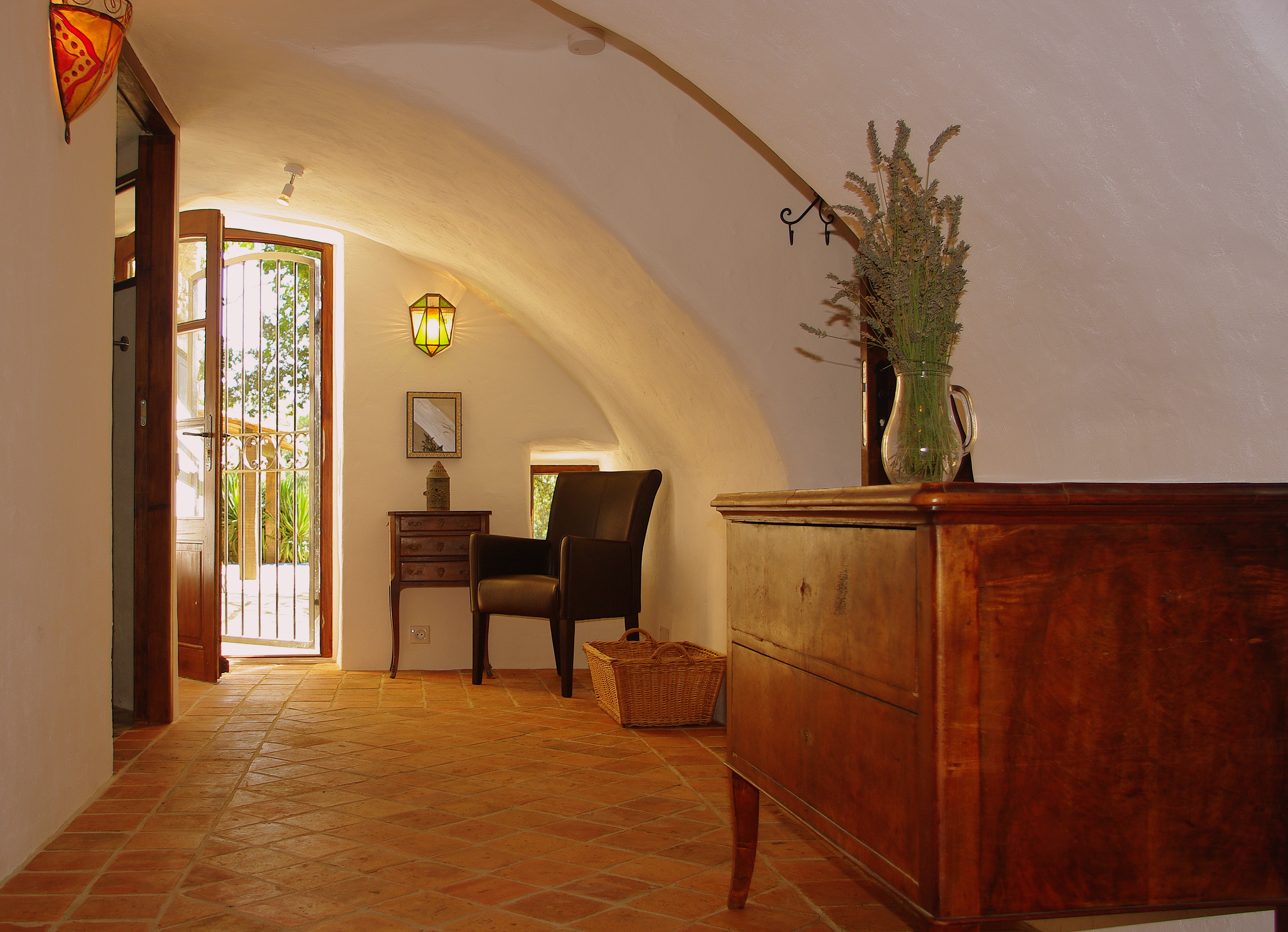 Vaulted hallway leading to entrance