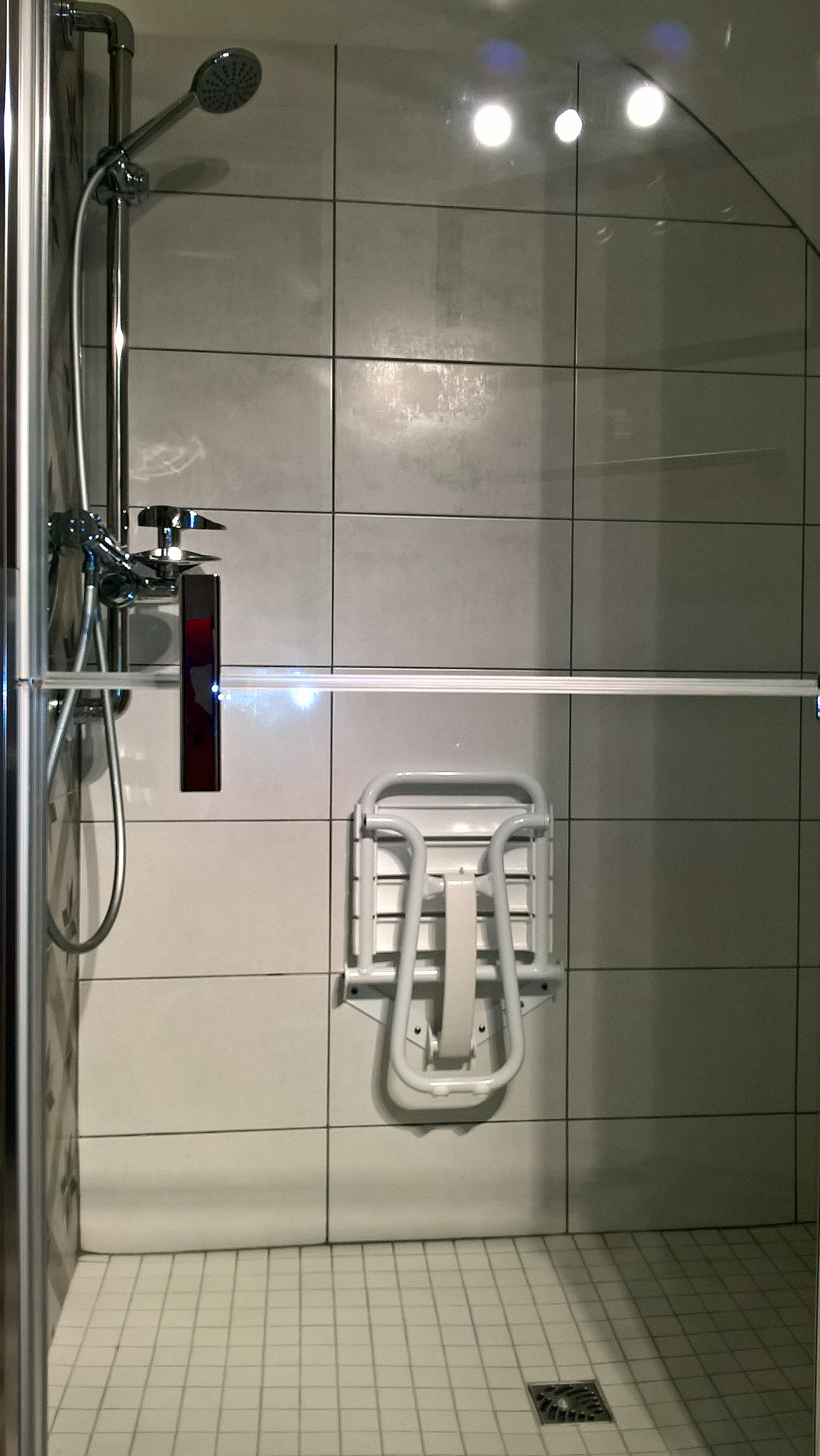 Wheelchair adapted shower with seat