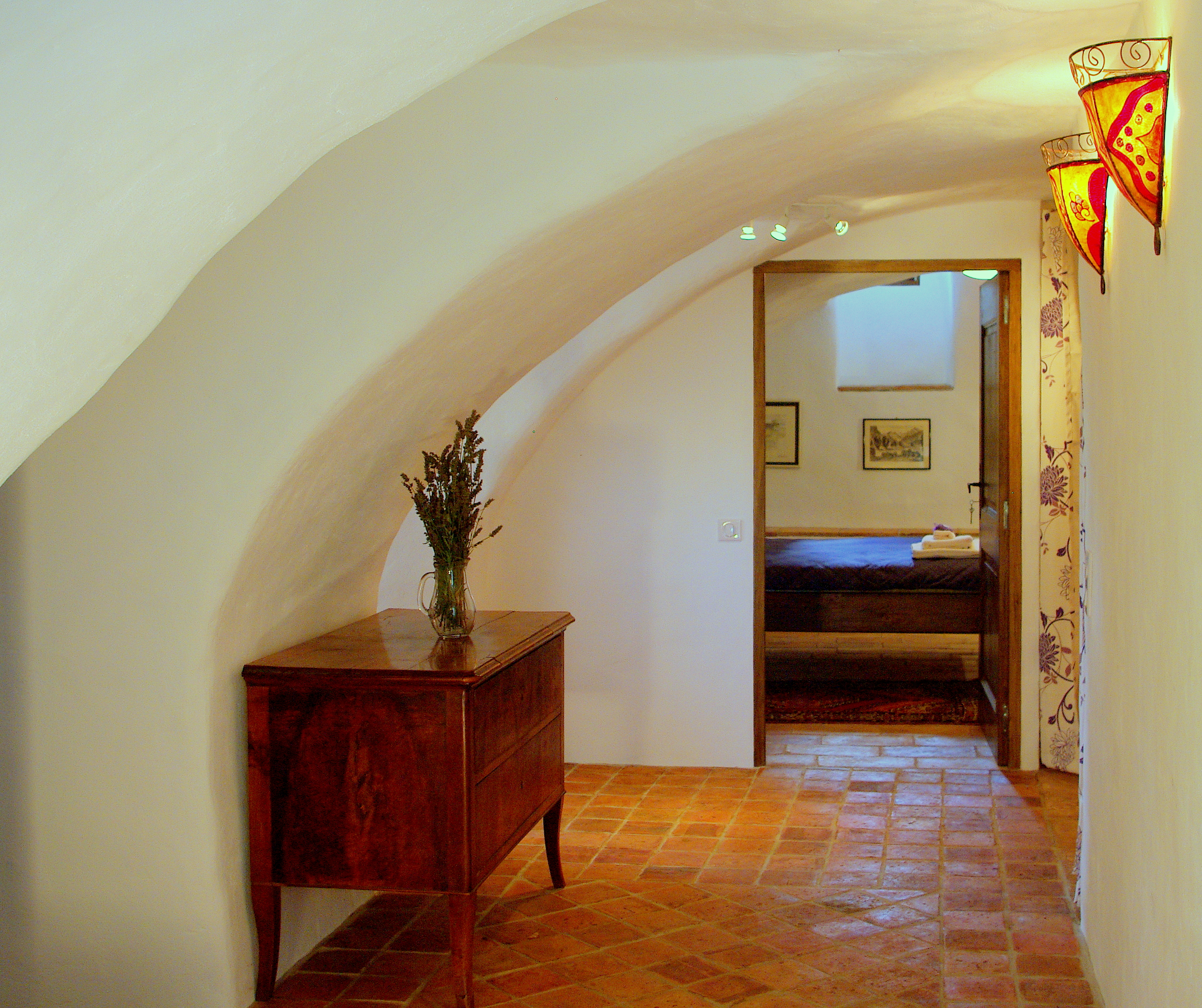 Vaulted hallway leading to rooms