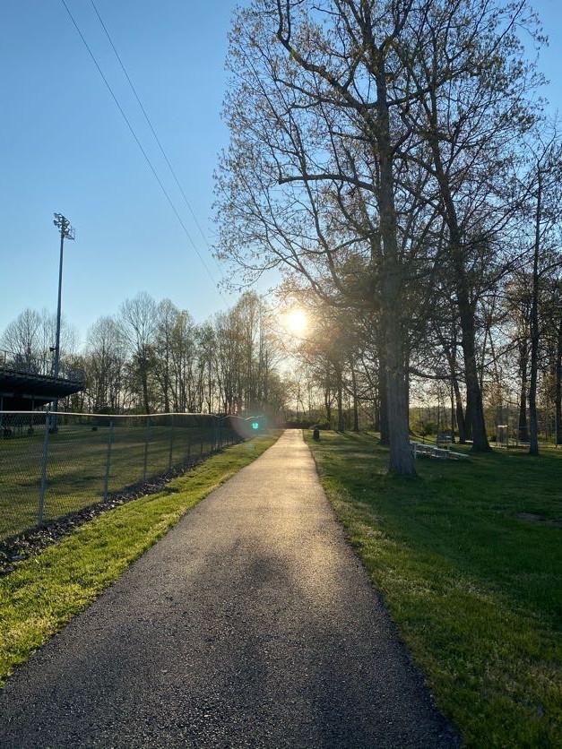 Walking trail football field side forwar