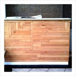Geometric, reclaimed-oak-clad bar