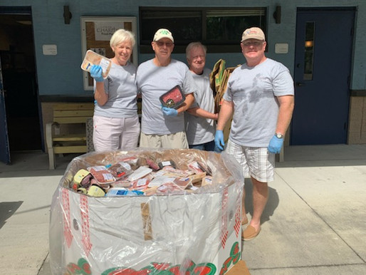 Catholic Charities Volunteers Assist in Giving Food to 913 Individuals in one day!