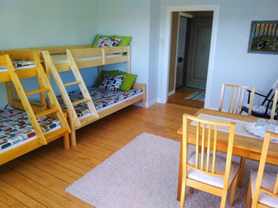 Storsjo-Prastgard_4-bedded-room_Storadorren.jpg
