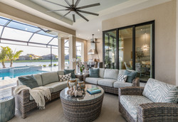Indoor/outdoor room with patio furniture near the inground pool