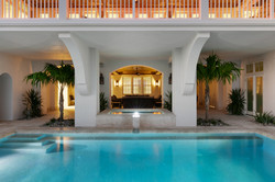 Pool area with indoor/outdoor living space