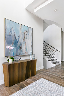 Luxury home entryway with console and artwork