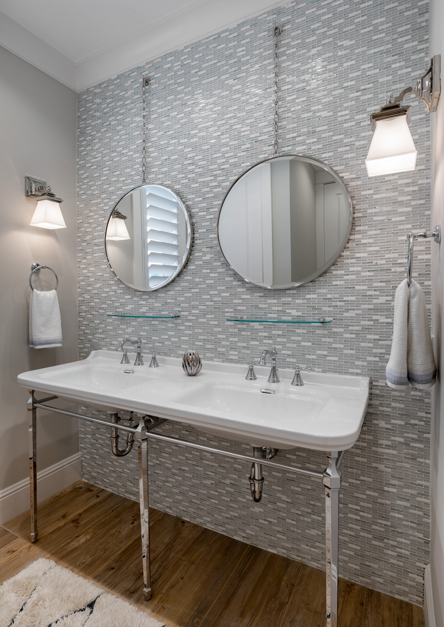 Bathroom with dual sinks and round mirrors
