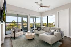 Second-floor living room with adjacent balcony