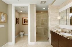 Luxury master bathroom in beige and brown tones