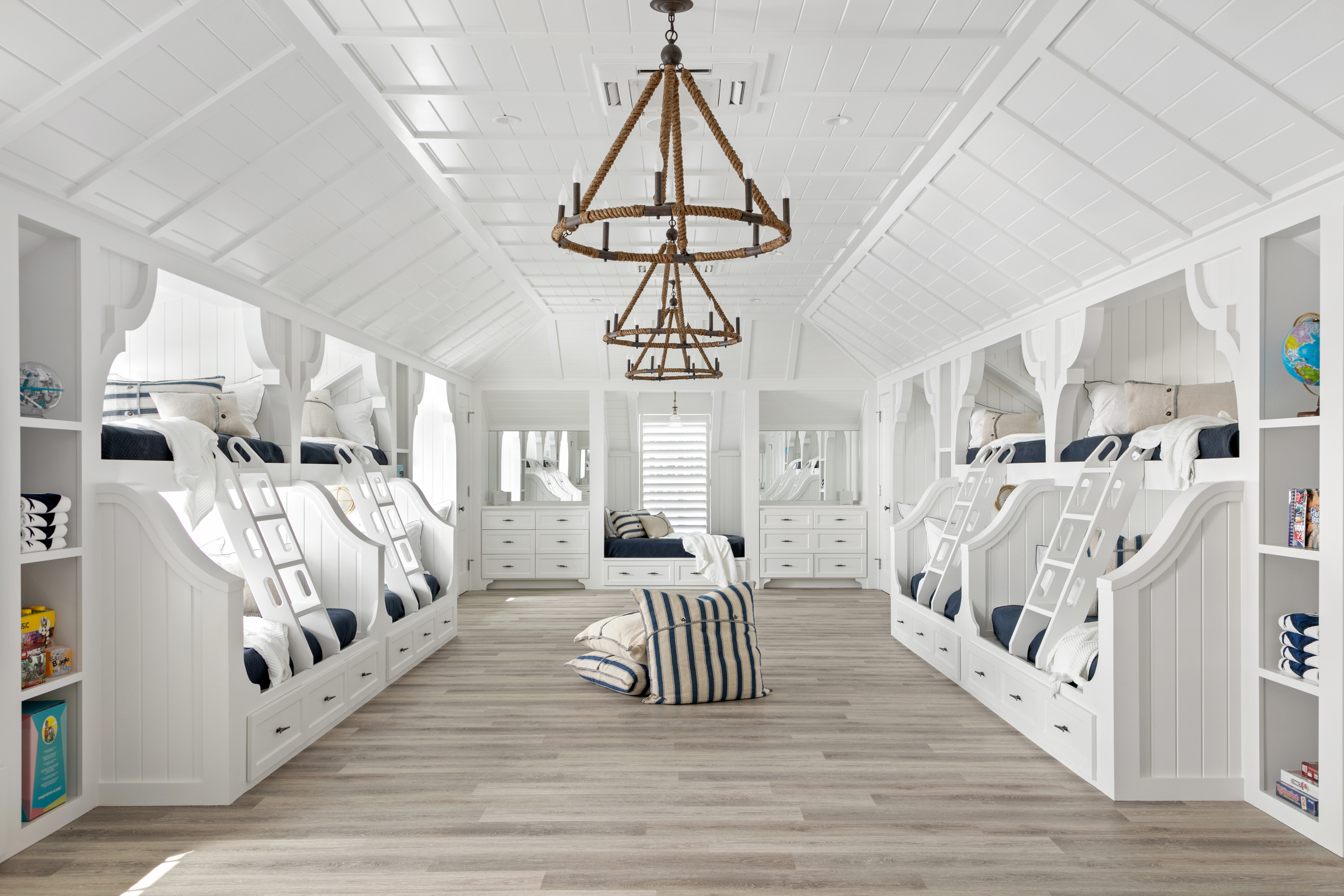 Kids' bunk bed room and play room in white and navy