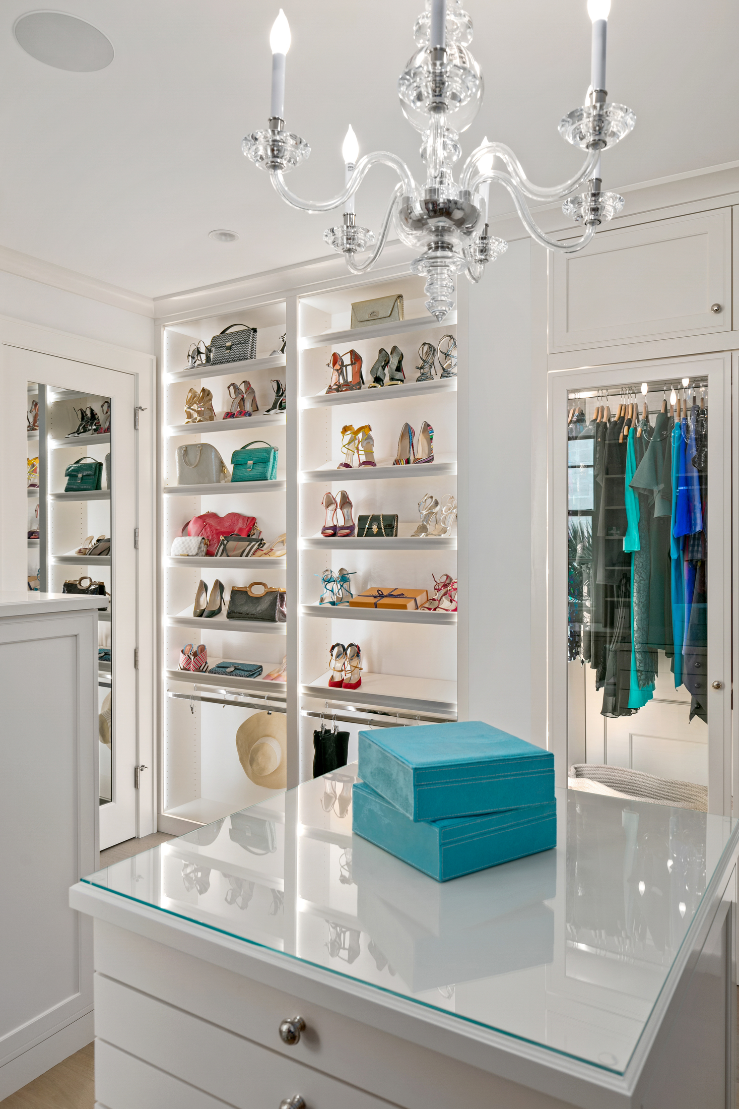 Luxury walk-in closet with chandelier