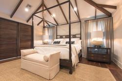 Vaulted ceiling bedroom in neutral tones