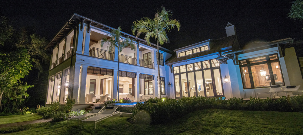 Exterior night time shot of Coastal Dutch home built buy Perrone Construction