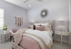 Guest bedroom in pastel pink and lilac