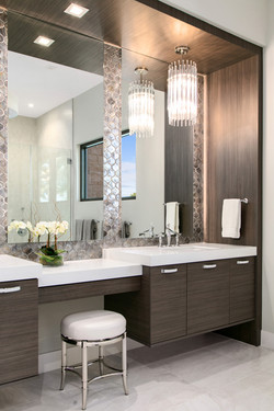 Alternate angle of dual sinks with vanity and chandelier