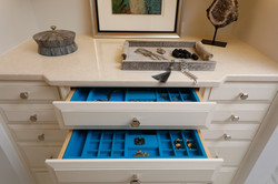 Jewelry armoire detail with blue lining