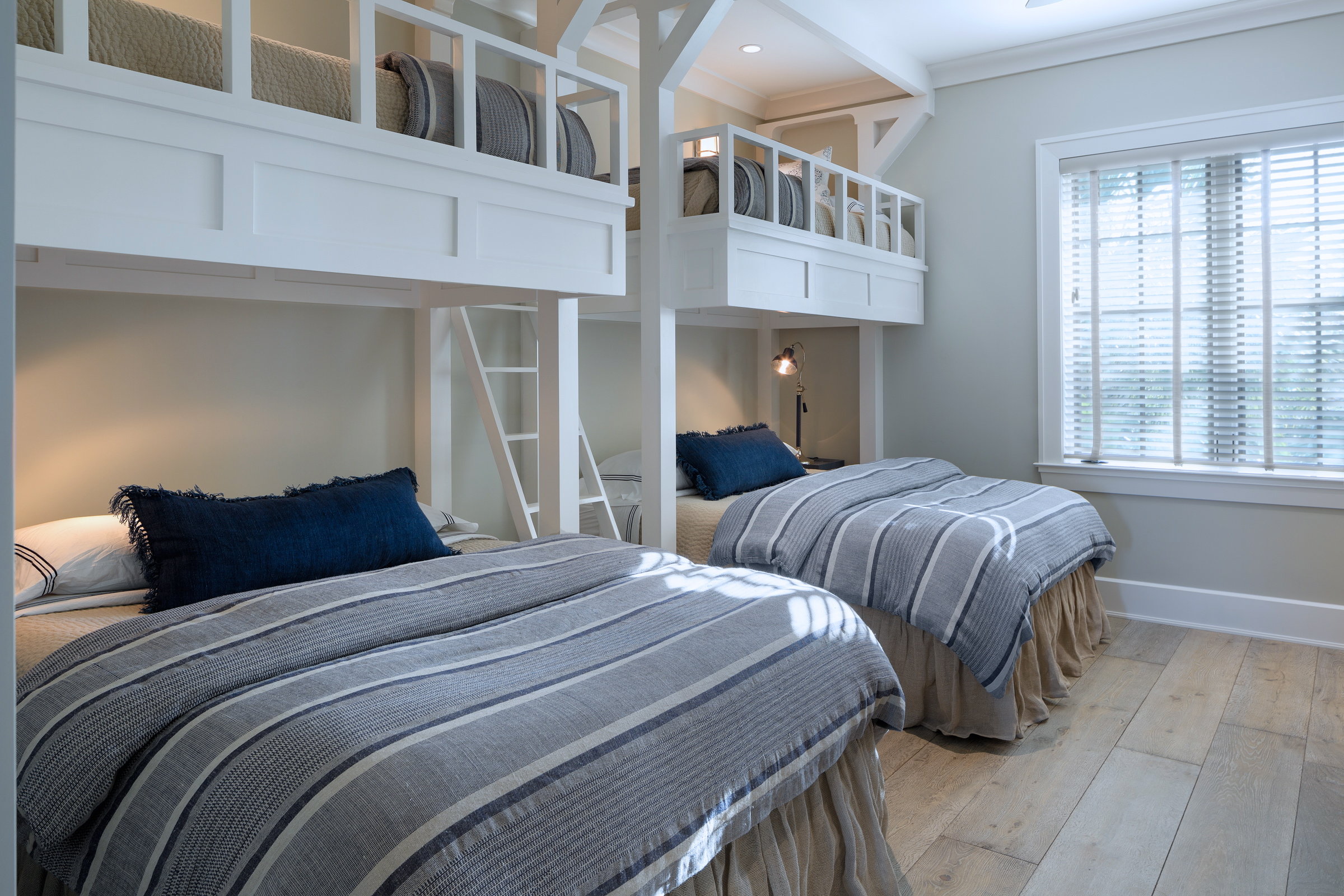 Bunk bed area with gray and navy accents