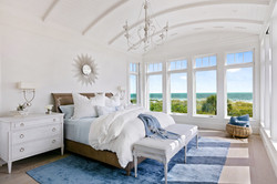 Coastal inspired vaulted bedroom design in blue and white