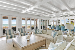 Modern coastal living room with waterfront view