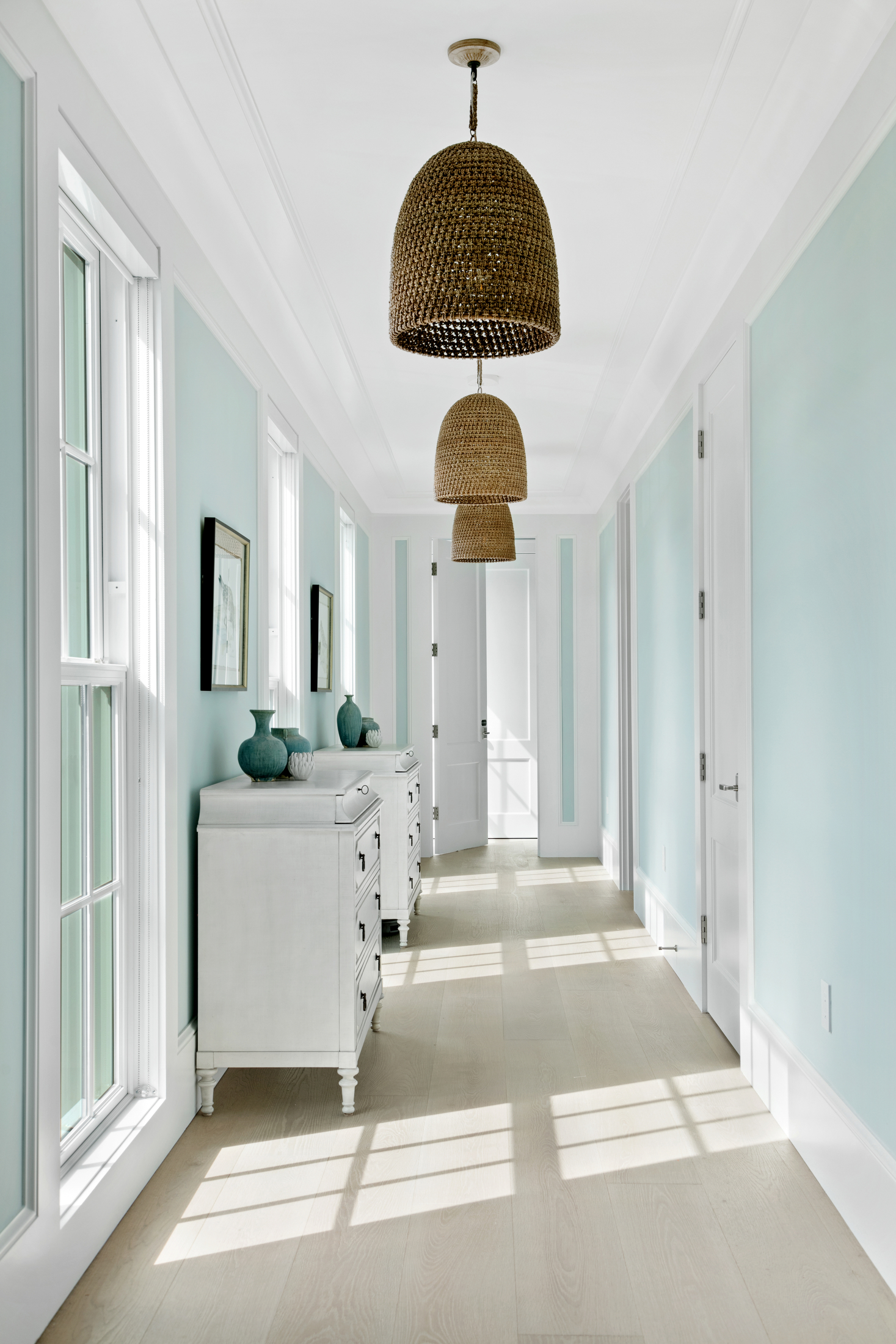 Hallway space with pendant lighting
