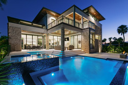 Midcentury modern luxury home exterior with pool