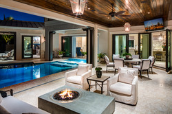 Outdoor living space with fire pit and infinity pool