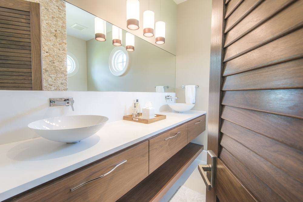 Modern bathroom with dual sinks and pendant lighting