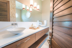 Modern bathroom with dual sinks and pendant lighting