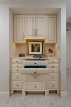 Jewelry armoire with cabinet underlighting
