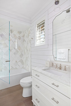 Coastal bathroom with shiplap and marble accents