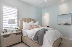 Guest bedroom in neutral beige and light blue tones