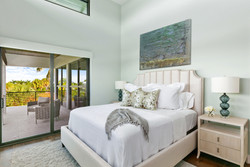 Guest bedroom with modern furniture and balcony