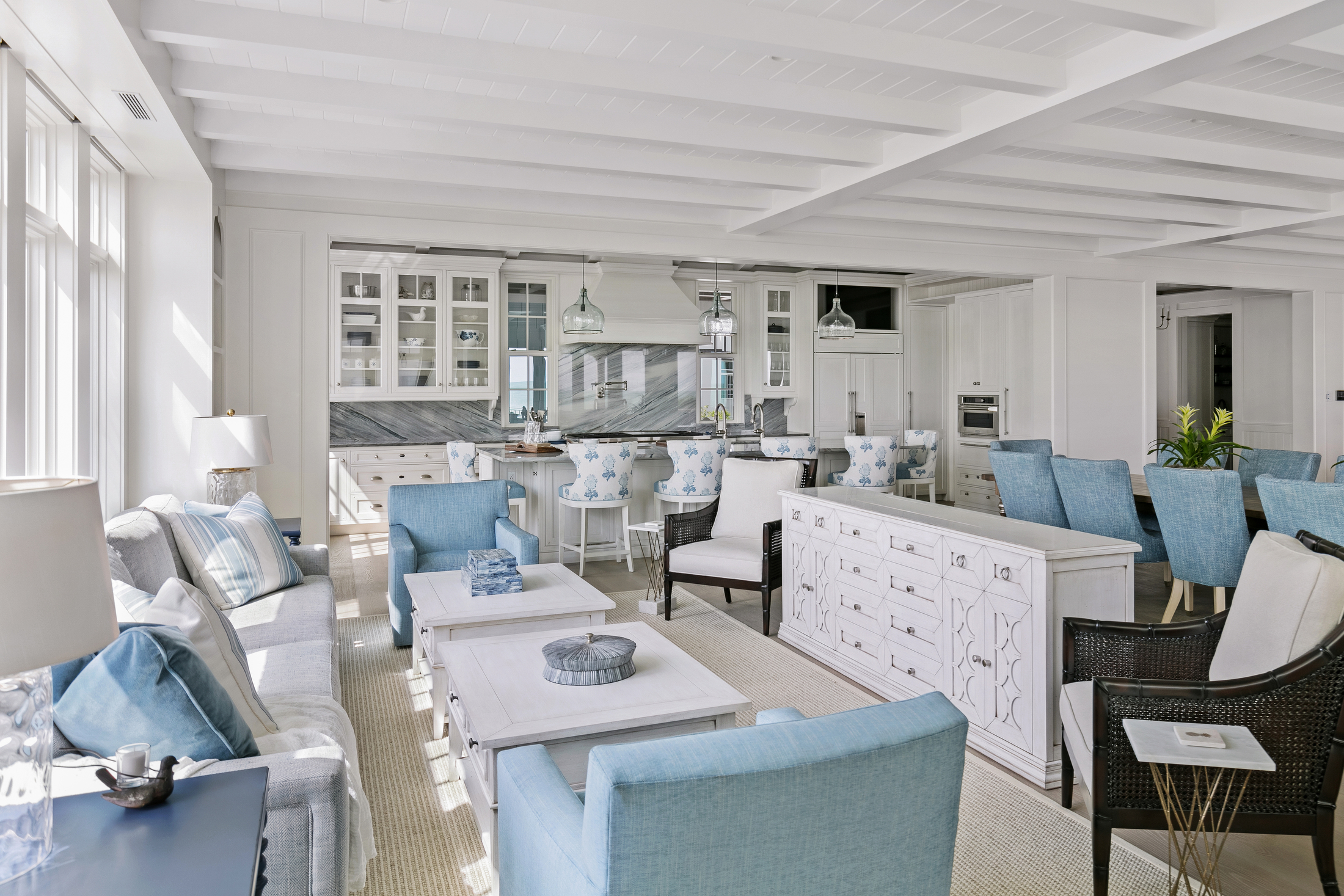 Great room designed in pale blue, white and gray