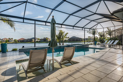 Inground pool and patio with a water view