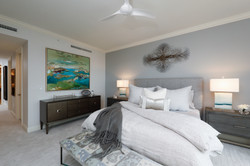 Master bedroom in white and grey tones