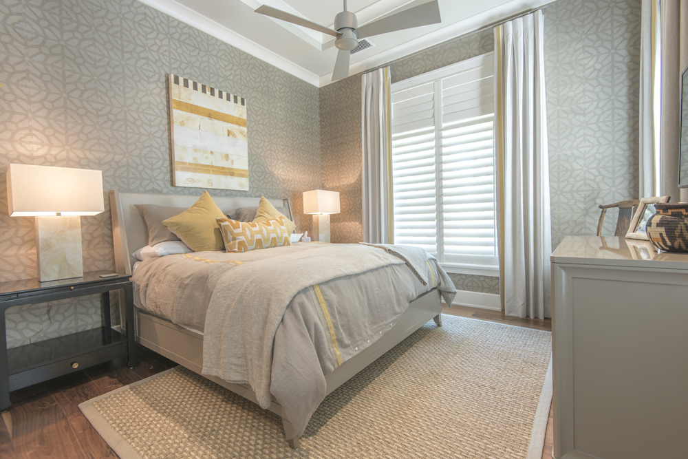 Guest bedroom in neutral tones with pops of yellow