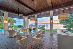 Outdoor living space overlooking water and boat docks
